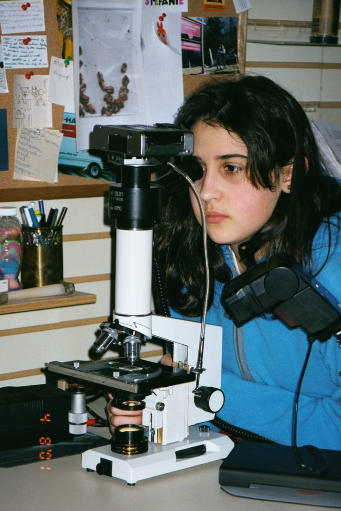Student Using a Compound Microscope